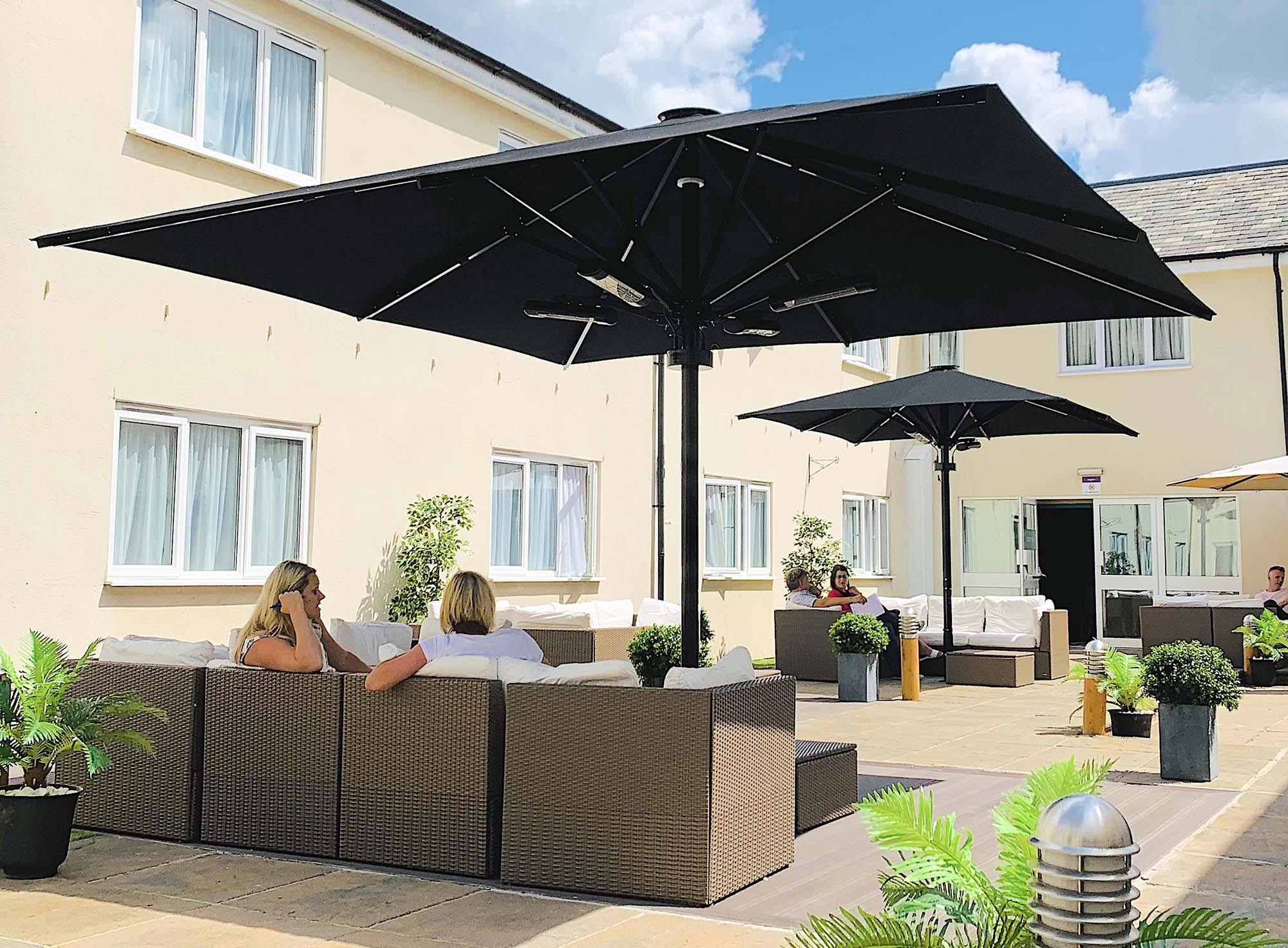 twin Umbrellas with outdoor seating area