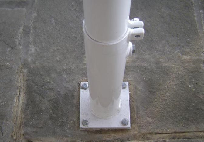 Umbrella pole bolted to ground